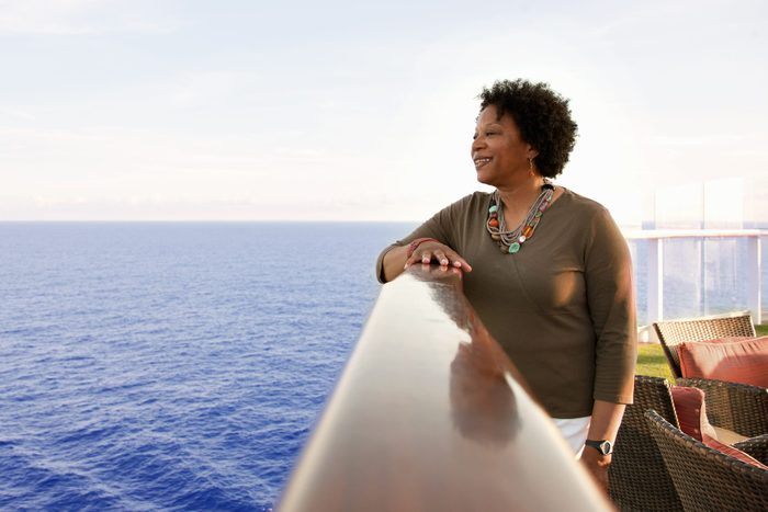 Woman on cruise ship deck looking into the ocean