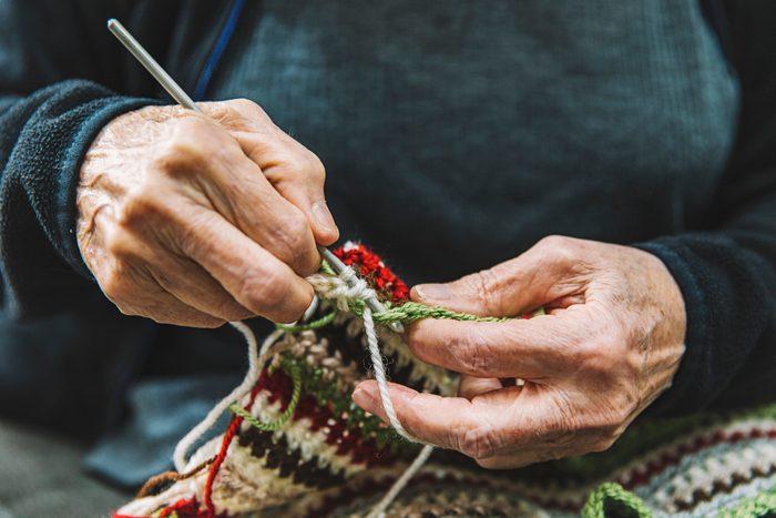 Close up of Senior woman crocheting