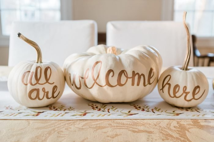 painted white pumpkins for fall dining home decor