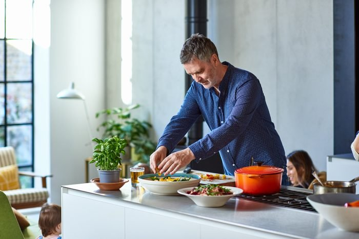 Mature man preparing healthy meal on kitchen counter
