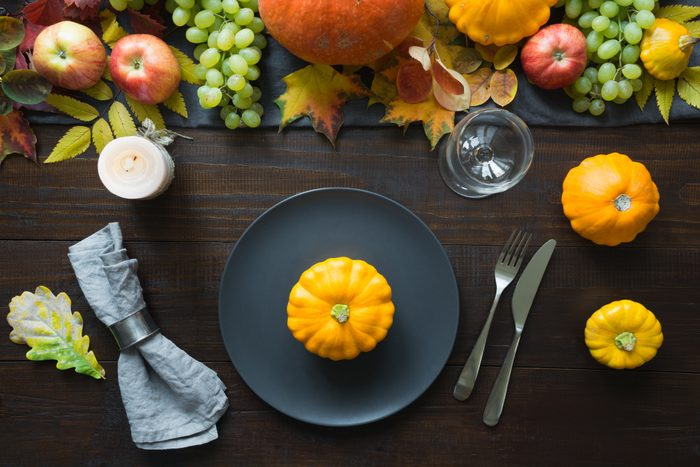 Fall table place setting with dark dinner plate