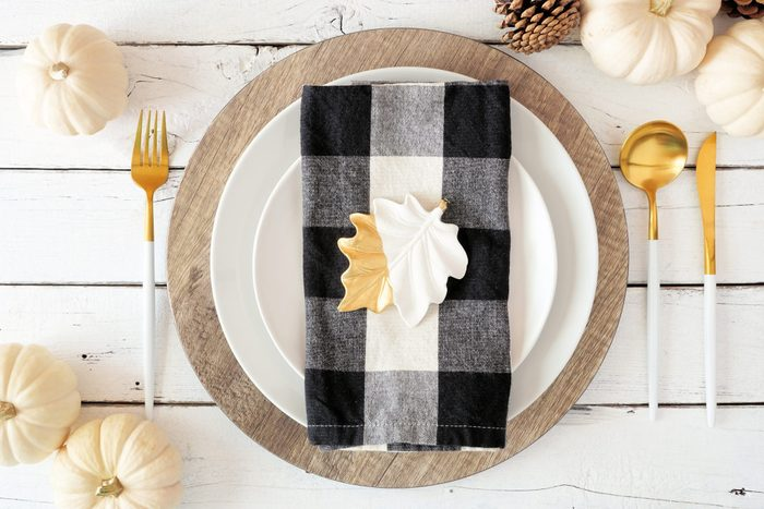 gingham plaid napkin on autumn table place setting