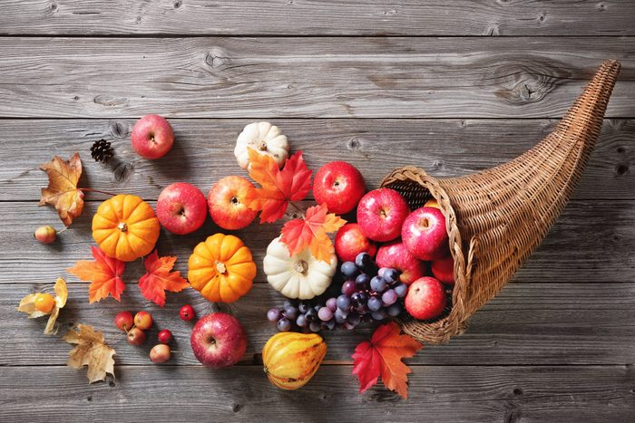 Thanksgiving cornucopia on a rustic wooden background