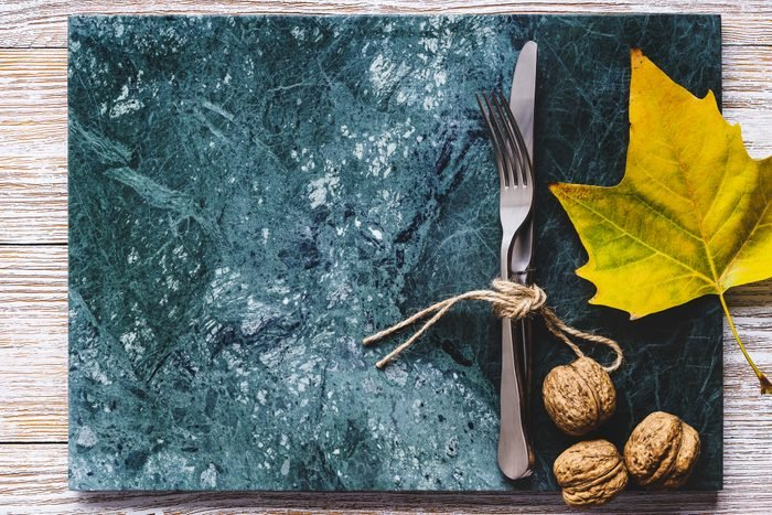 marble place setting on autumn decorated table