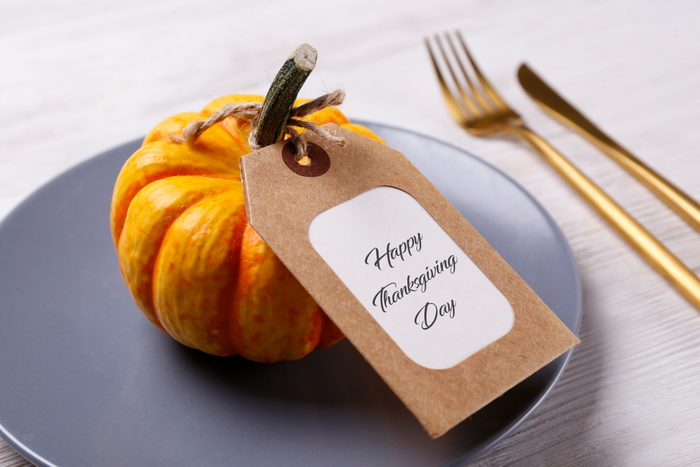 thanksgiving table name card on pumpkin