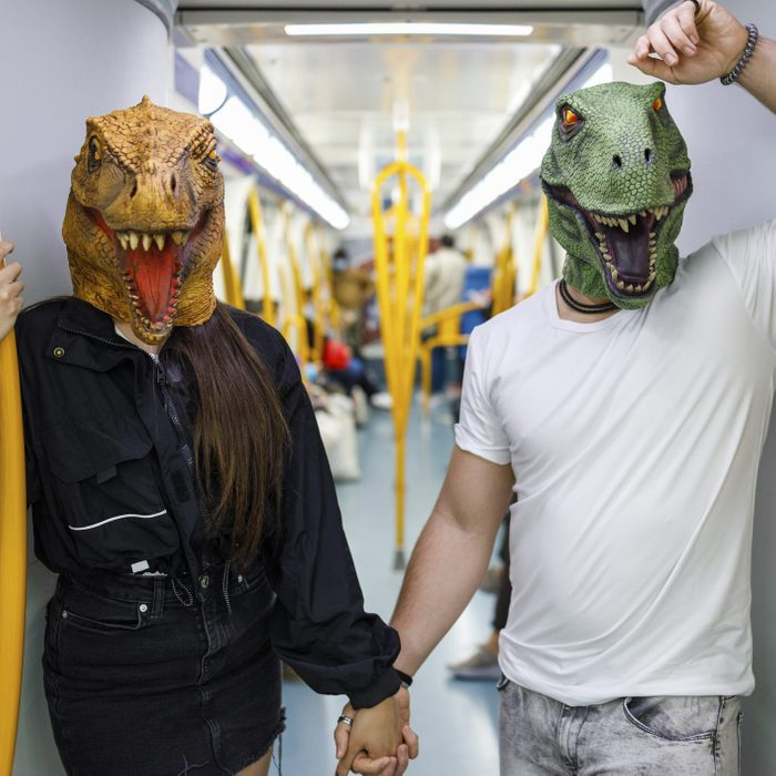 couple dressed as dinosaurs from jurassic park for halloween