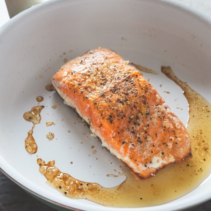 cooked salmon in frying pan