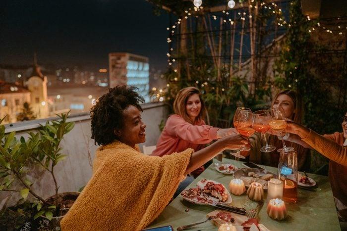 group of girls having dinner on a terrace