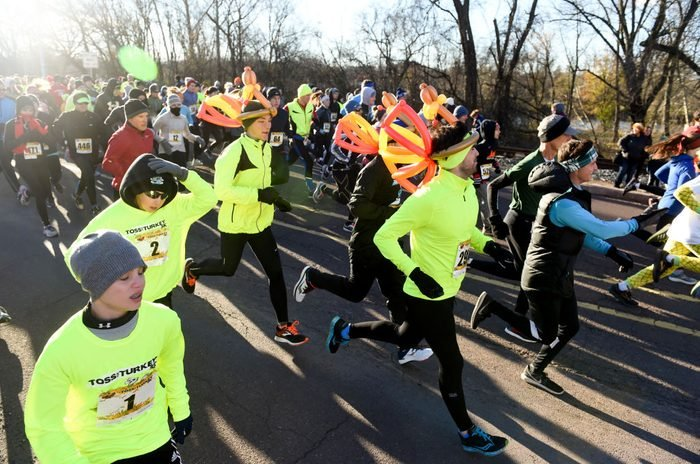 During the Toss Your Turkey and 5K Turkey Trot at Montgomery County Community College Thursday morning November 22, 2018. Before and after the race, participants could throw a frozen turkey to compete for prizes. Photo by Ben Hasty