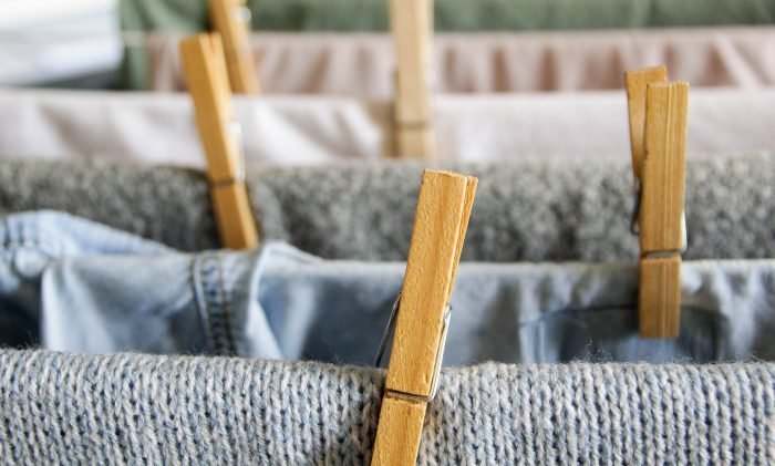 close up of laundry on a drying rack with clothes pins