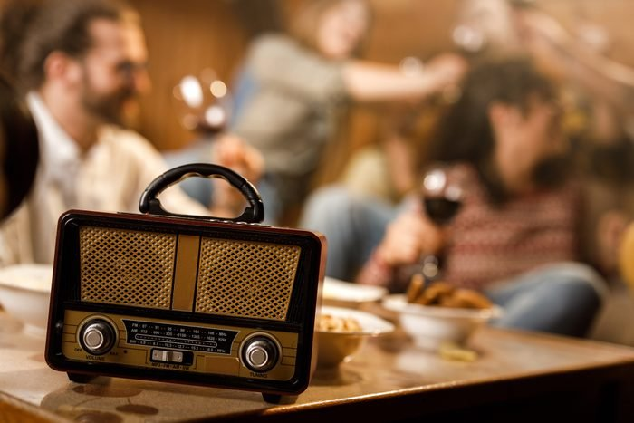 retro radio on table during friendsgiving party at home
