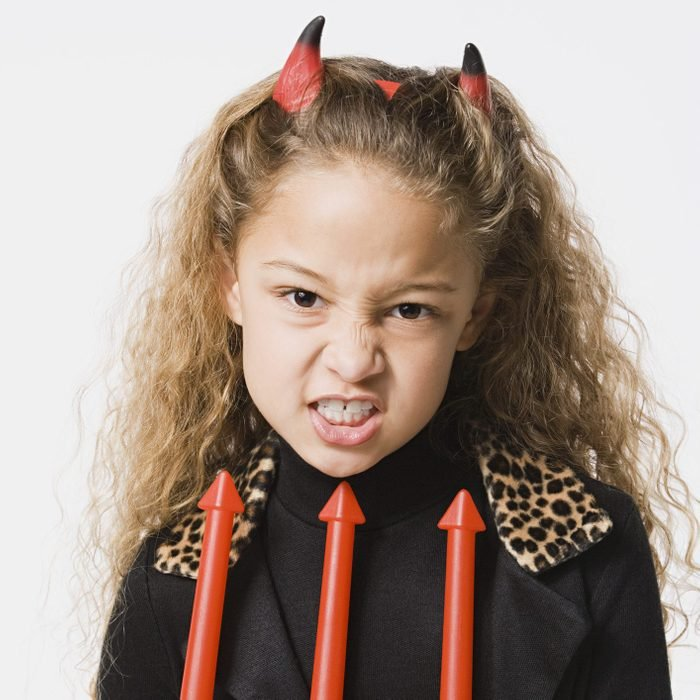 young girl dressed as a devil for halloween