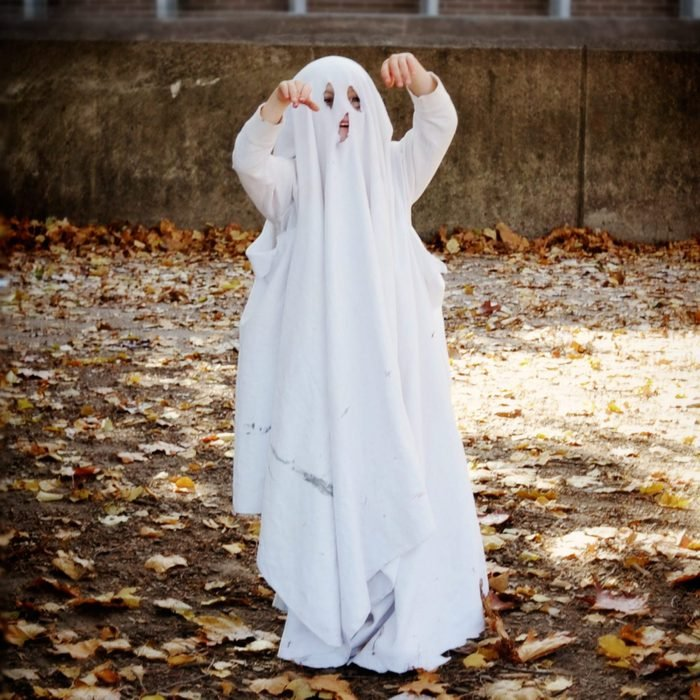 young child dressed as a ghost for halloween costume