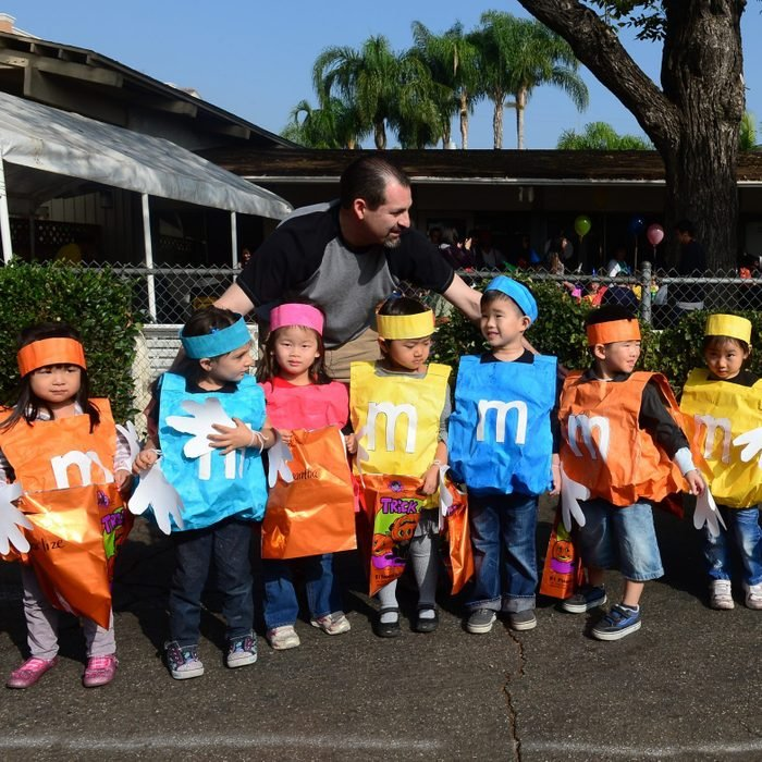 young children dressed up as M&Ms candy for halloween