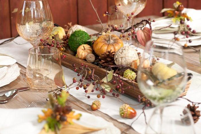 Autumn Dining Table with pumpkin centerpiece