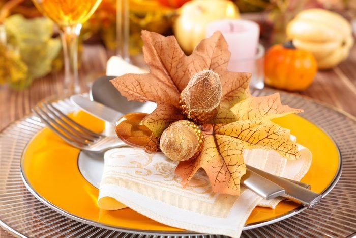 Thanksgiving dinner decoration with colorful accent plates