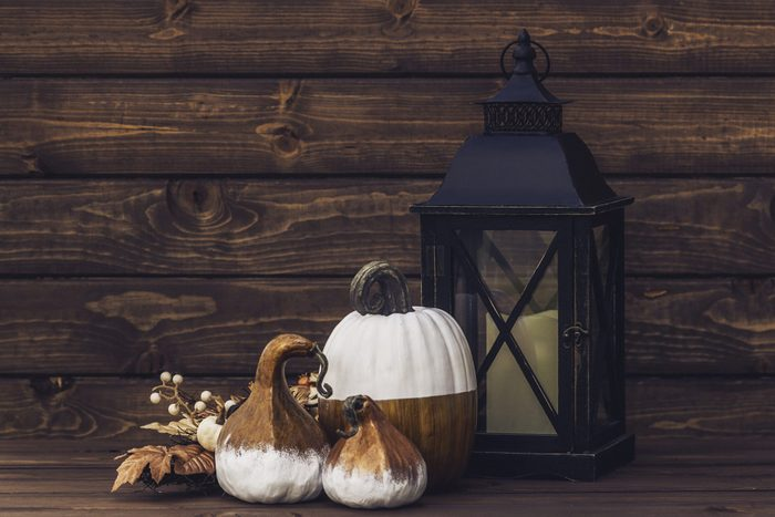 rustic lantern and pumpkin decor