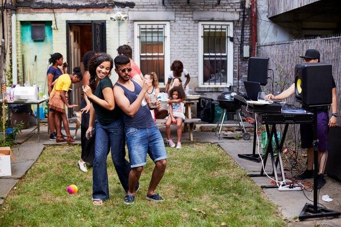 Couple dancing at backyard dance party