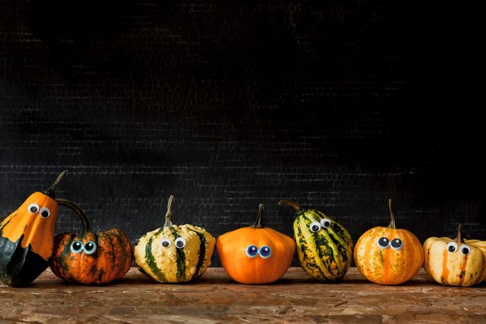 mini pumpkins with googly eyes decorations