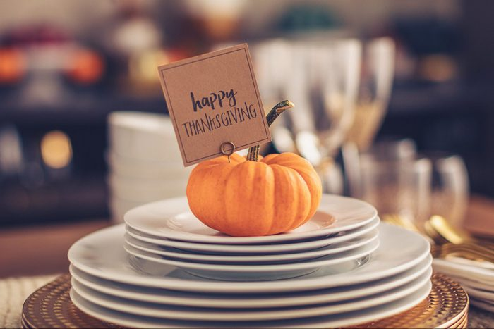 pumpkin name card holder on dinner table