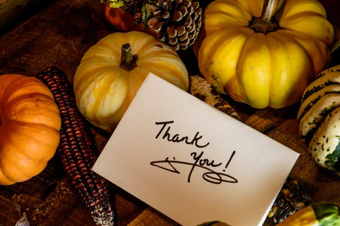 thanksgiving thank you card with pumpkins on table