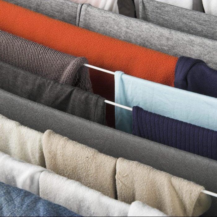 clothing hanging on laundry drying rack