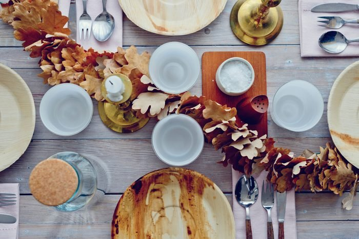 thanksgiving dinner table with leaf garland
