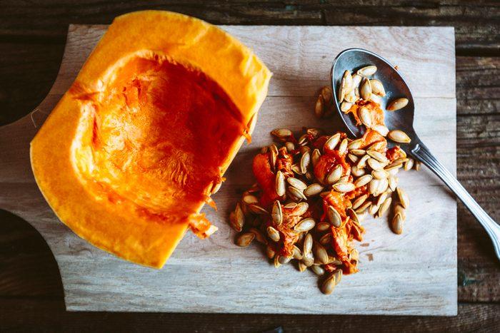 Hollowed pumpkin with pumpkin seeds