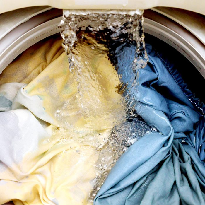 water filling a washing machine full of clothes