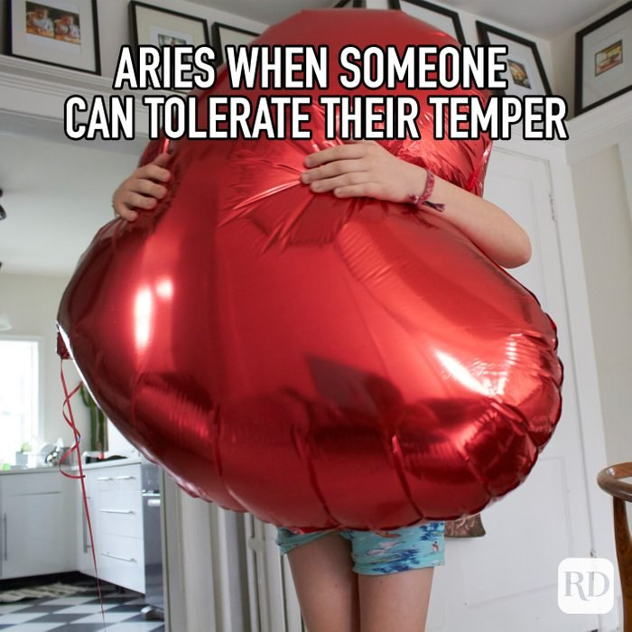Aries When Someone Can Tolerate Their Temper meme text on image of person squeezing a giant heart shaped balloon
