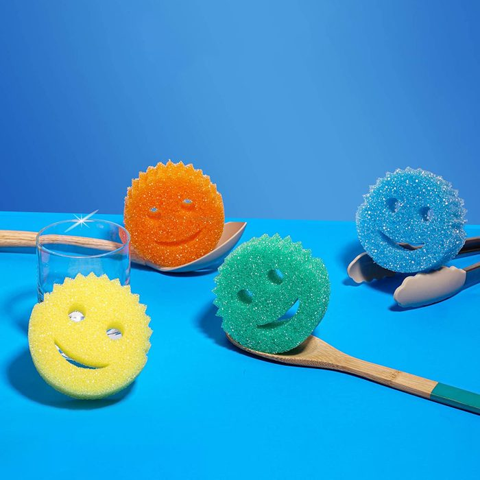 colorful Scrub Daddy Sponges On Blue Background