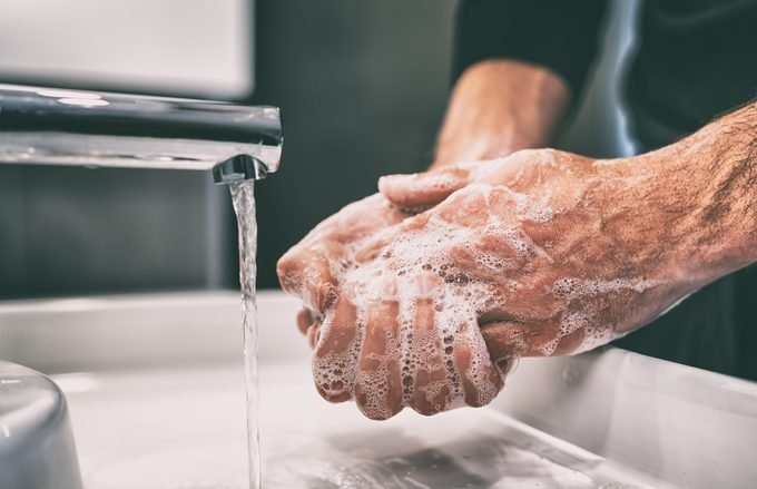Coronavirus pandemic prevention wash hands with soap warm water and , rubbing nails and fingers washing frequently or using hand sanitizer gel.