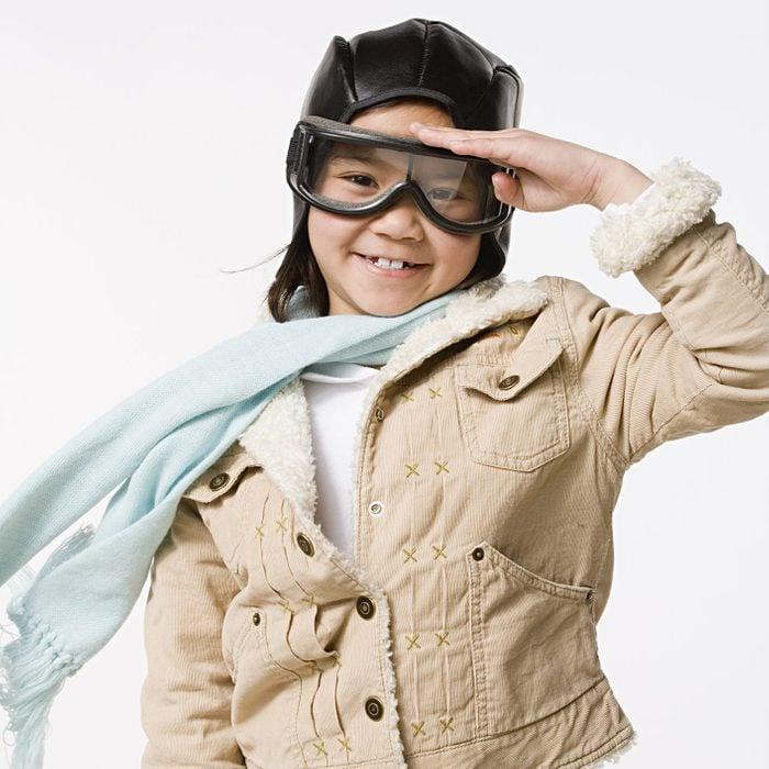 young girl wearing aviator halloween costume