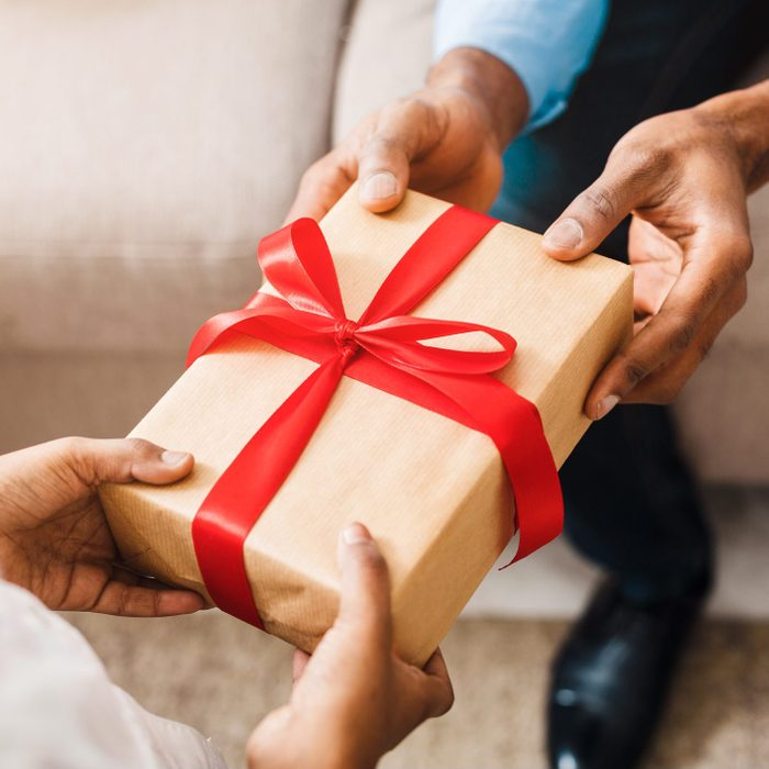 man regifting a gift to his friend