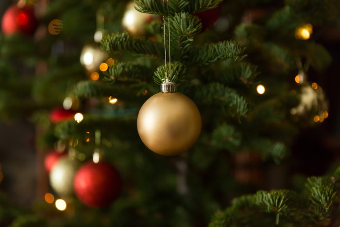 Christmas balls on christmas tree, great light with bokeh with shadows from branch.
