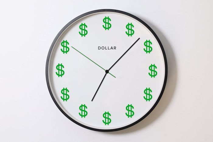 A clock with green Dollar symbols instead of numbers