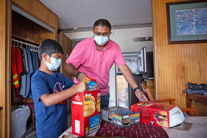 Sean Patel, left, takes down a grocery list for one of his extended stay residents Robert Phelps at the Quality Inn in Kodak, Tenn.