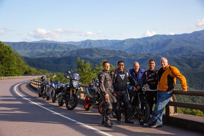 Steve Smith, from left, Sean Patel, Ed DeMik, Pinkesh Patel and Todd Patrick pose for a photo while on a motorcycle ride on the Foothills Parkway in Great Smoky Mountain National Park