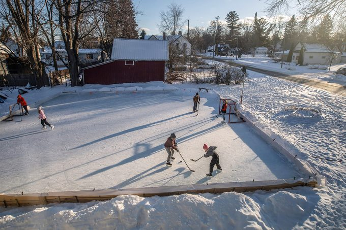 Kids skate on a homemade ice rink made by Scott Chittle at his home in Manton
