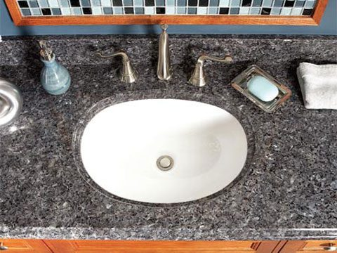 granite tops used to be for big buck bathrooms only but now you can get one for less than 200 at home centers including an attached under mounted sink - Bathroom Makeover Contest