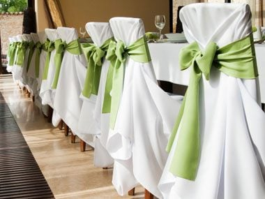 wrap bows around your dining room chairs you can even tie on christmas ornaments for extra sparkle says better homes gardens - Cheap Christmas Decorations