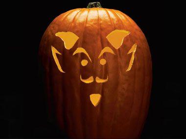 How do you use a pumpkin carving stencil?