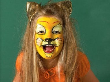 apply yellow face paint base with a sponge then draw lion eyes by using white face paint on a pad applicator and outlining them with a paintbrush with - Easy Face Painting Halloween