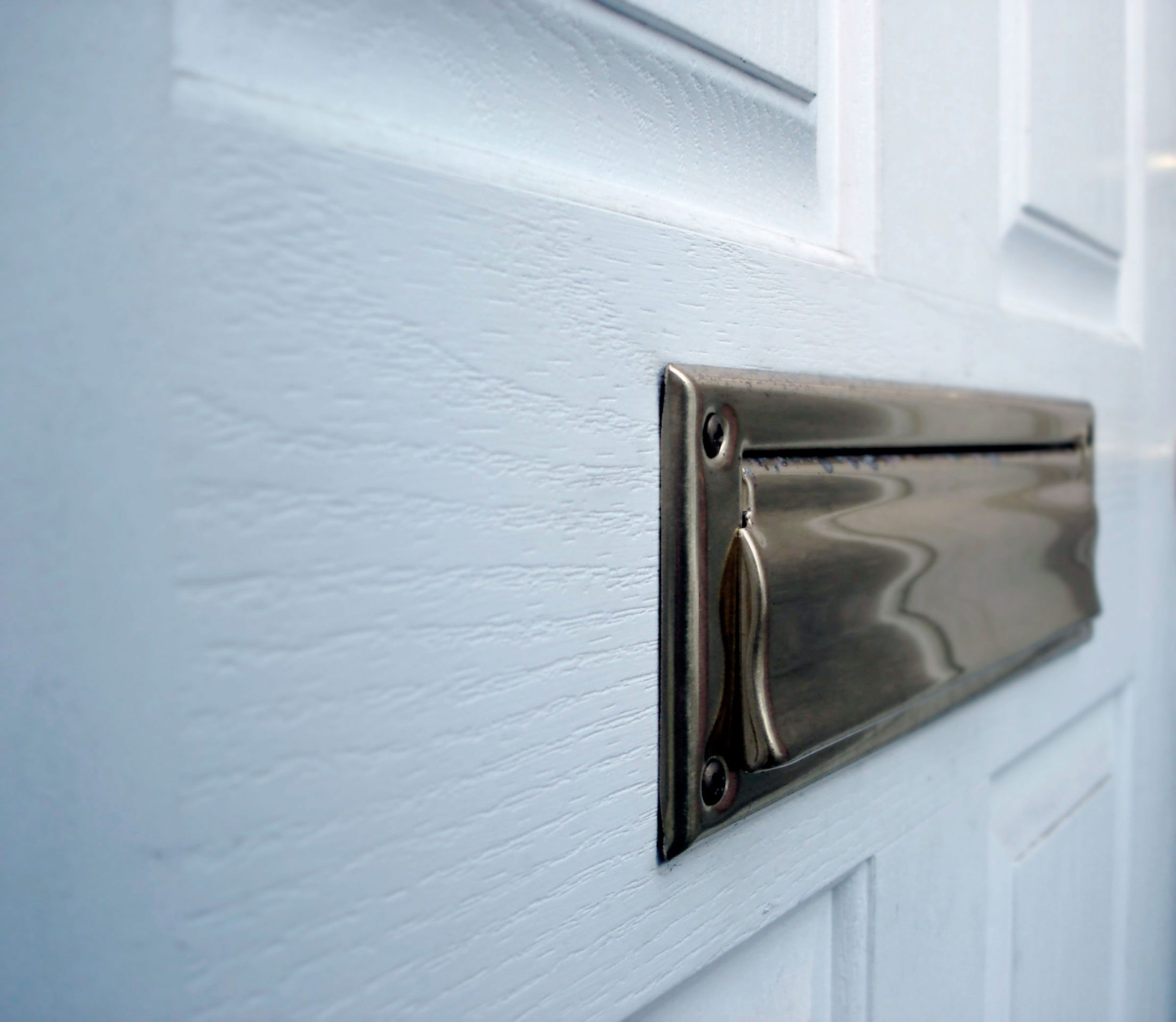 3. A mail slot goes against the wood grain, weakening the horizontal integrity of  a door and making it easier to kick in.