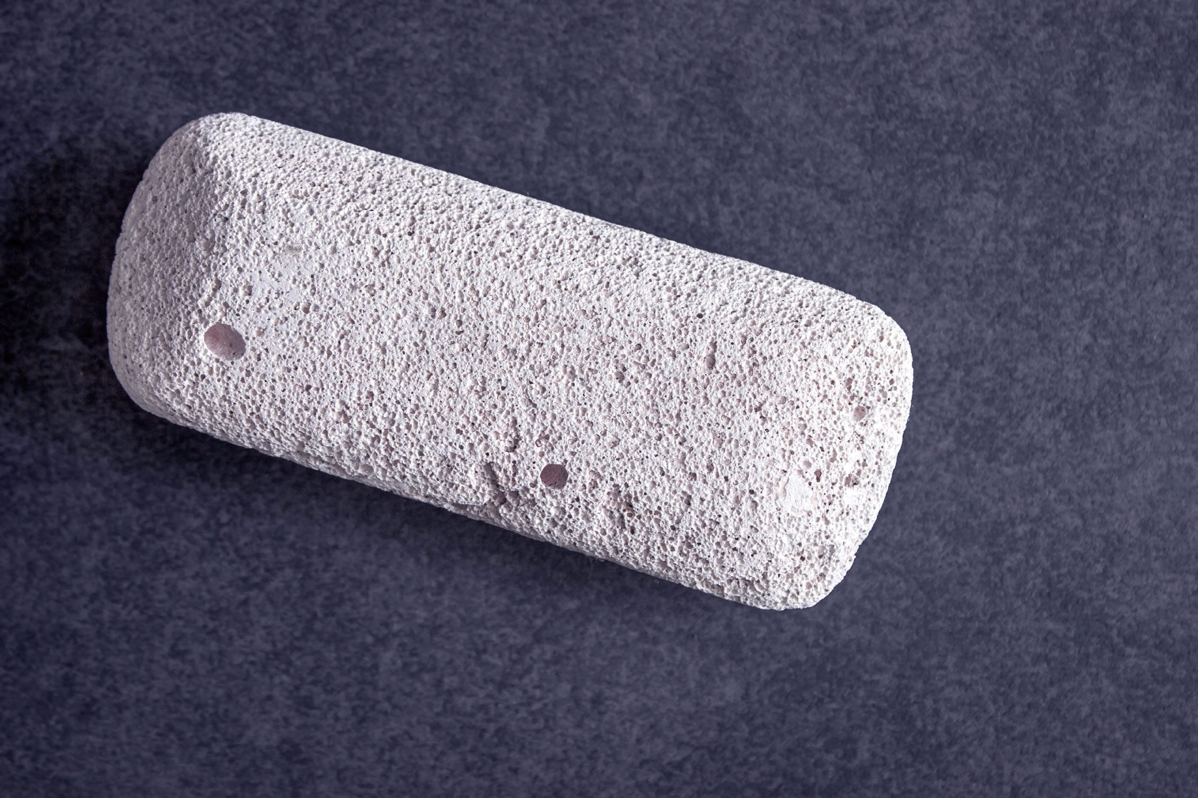 A wet pumice stone will clean a dirty oven faster than any spray-on product.