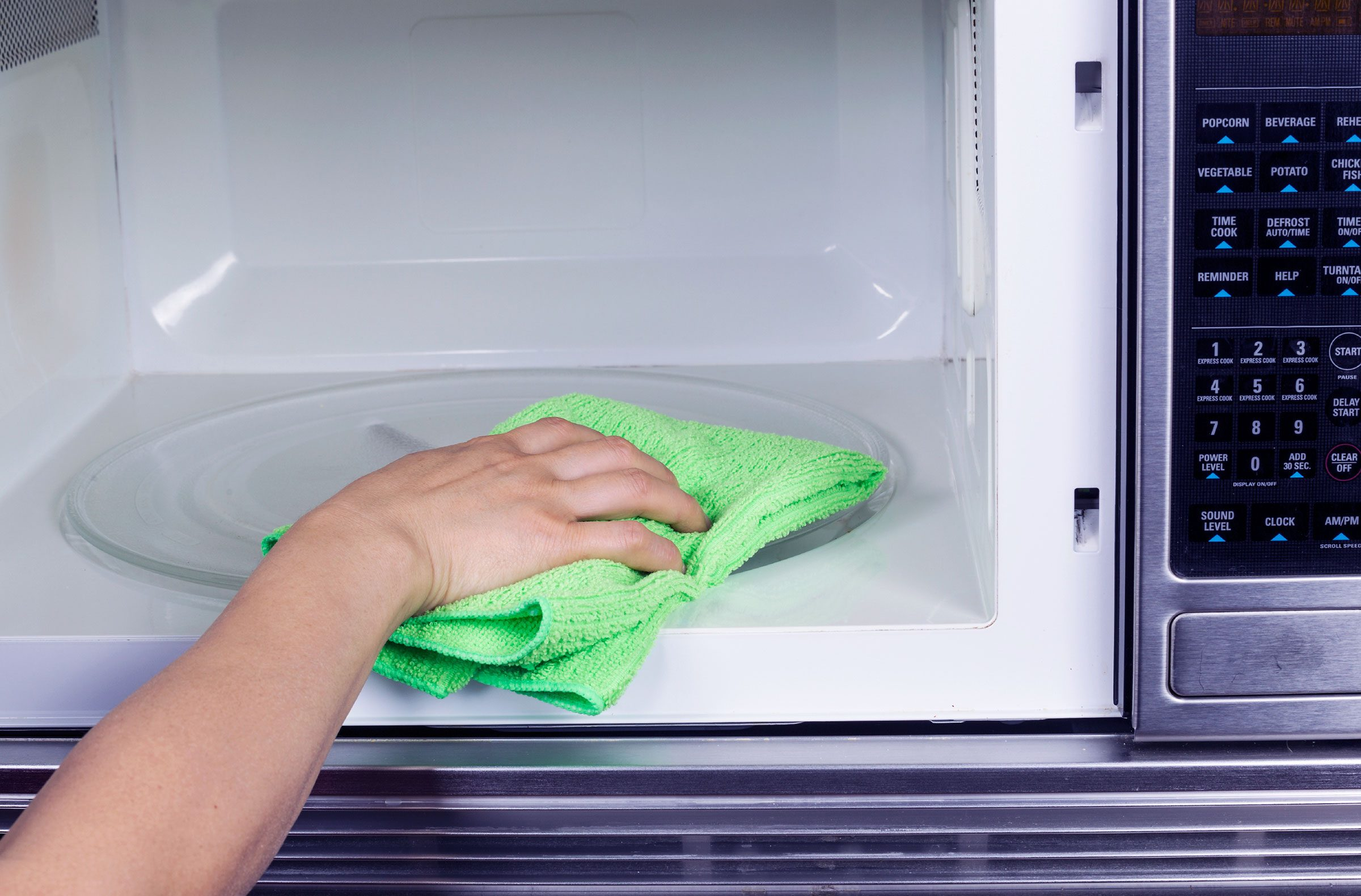 To clean your microwave oven, microwave a cup of water with some baking soda in it until it's boiling.