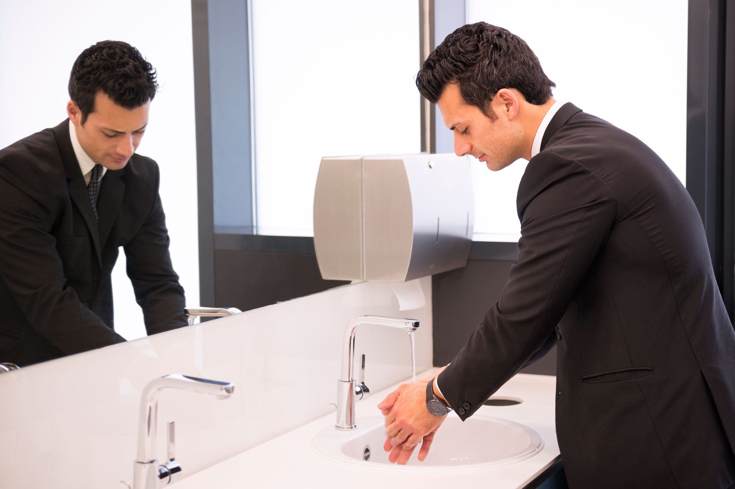 My boss and I walk into the restroom together—am I supposed to carry on a conversation?