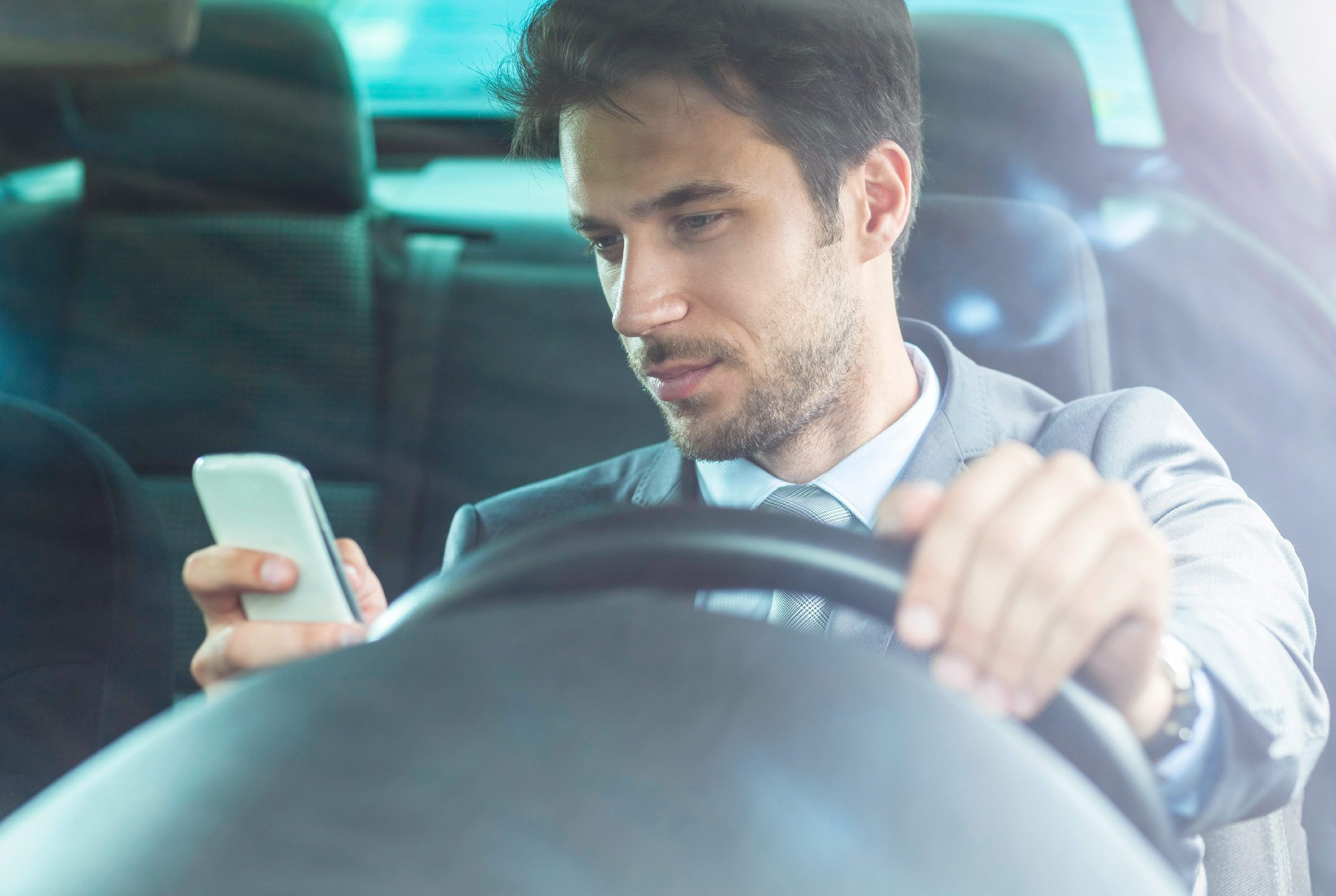 "Don't text while driving, even ""hands-free."""