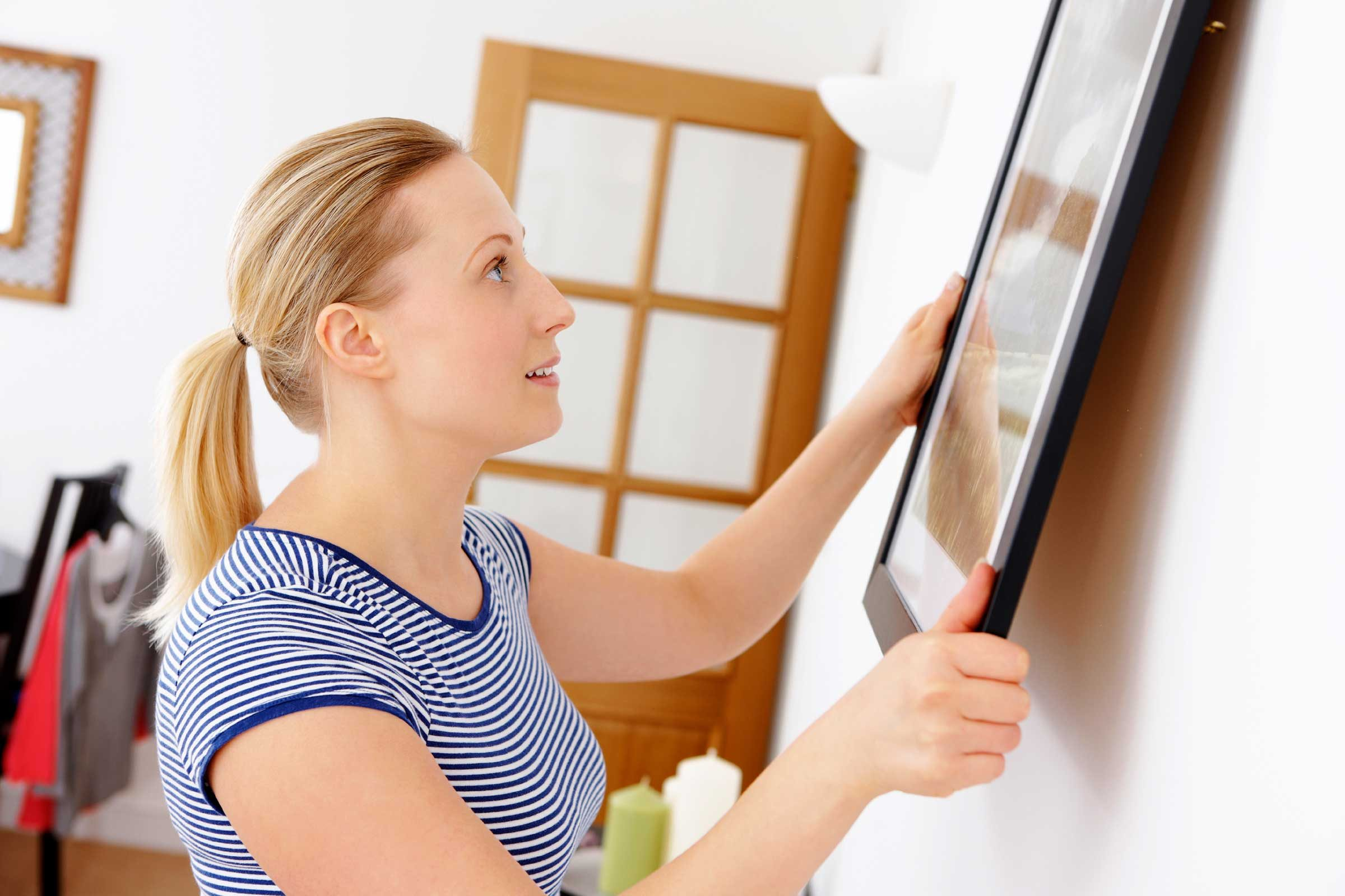 How to Hang Pictures Perfectly: 9 Common Mistakes to Avoid