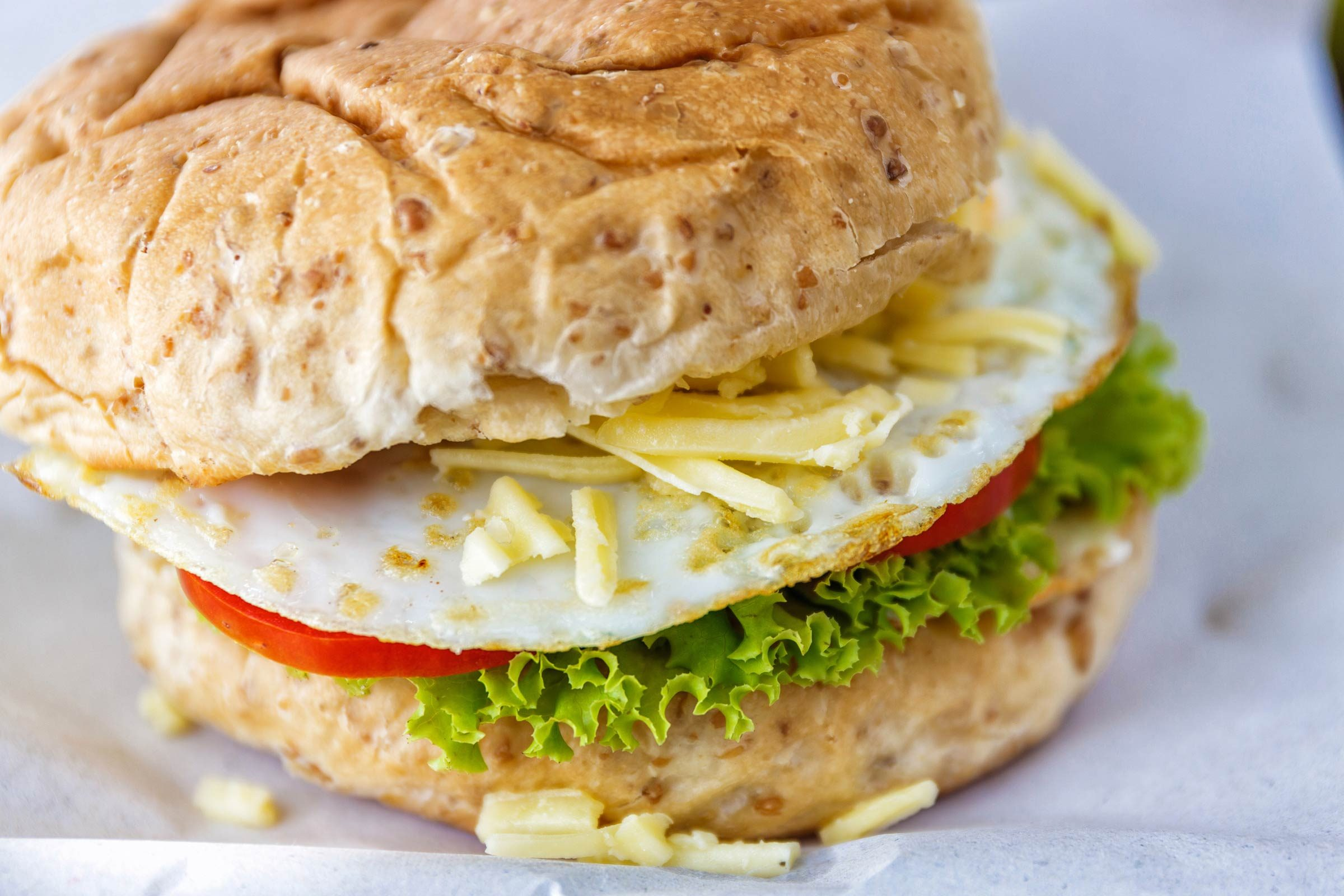 Make a sliced egg and tomato sandwich with pesto mayo